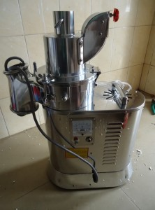 Automatic continuous grinder machine